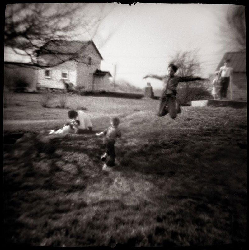 Boys Flying. Amesville, Ohio, 1976 © Nancy Rexroth